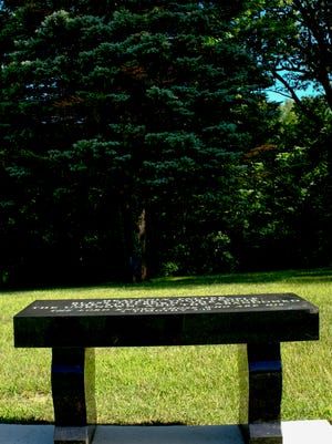 A bench donated by Sparrow Hospital marks the spot where remains of cremated unclaimed bodies and stillborn children at St. Joseph Catholic Cemetery will be interred.