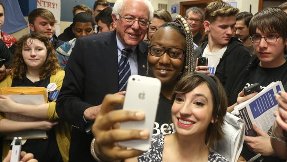 Vermont Sen. Bernie Sanders poses for a selfie with