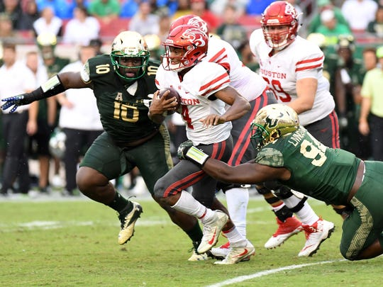 Houston Cougars quarterback D'Eriq King (4) runs the ball in the second half against the South Florida Bulls at Raymond James Stadium.