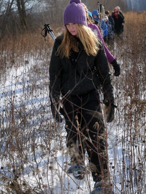Talya Loken of Fond du Lac in a line of about 75 people who took part in a snow shoeing event and tour of the winter side of the prairie at UW-Fond du Lac.