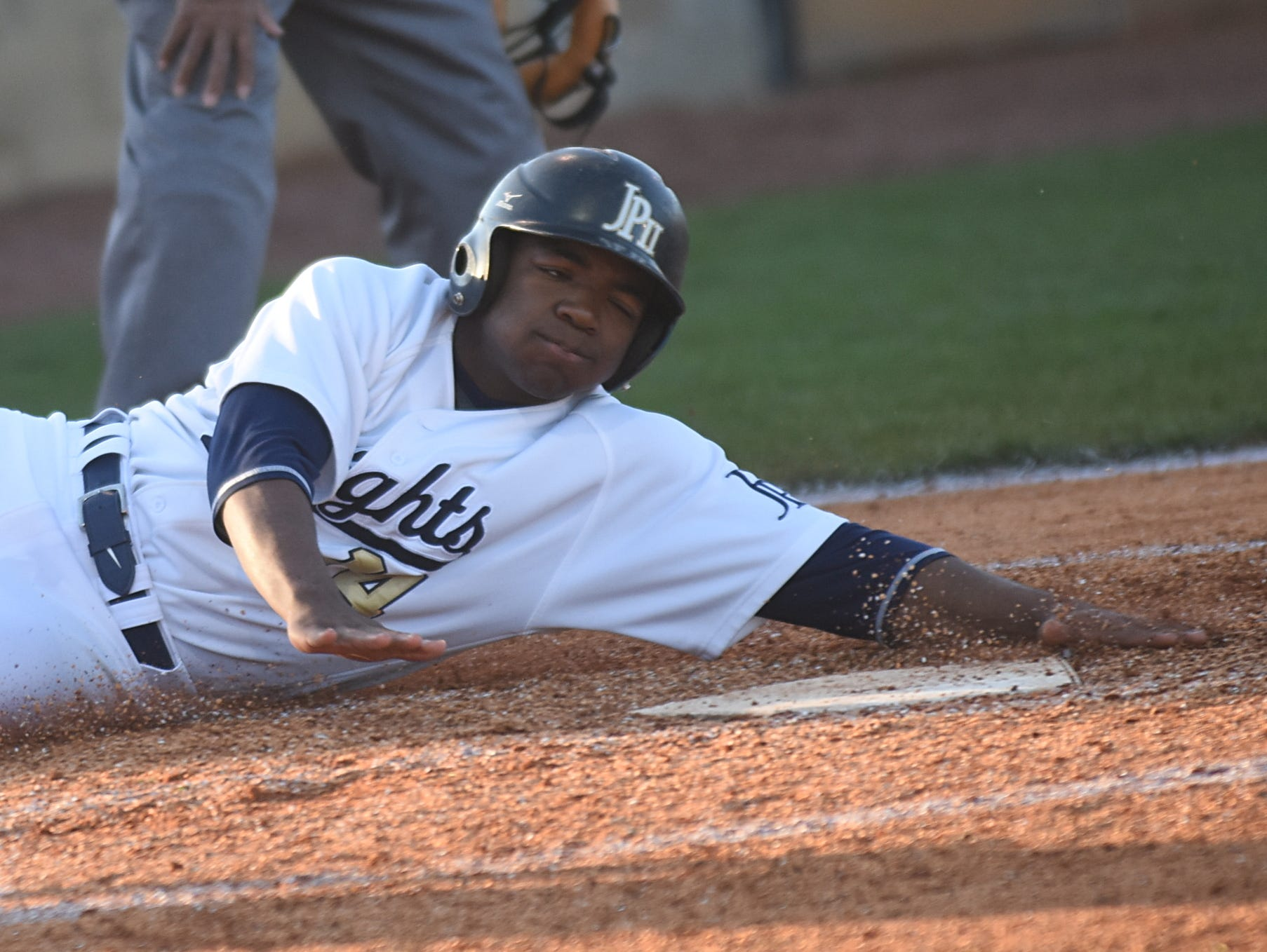 Pope John Paul II High junior C.J. Laws slides into home plate safely during the five-run fourth inning.