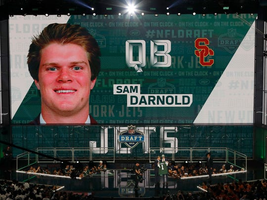 USC's Sam Darnold is shown on the video screen as he is greeted on stage by Commissioner Roger Goodell after being picked by the New York Jets during the first round of the NFL football draft, Thursday, April 26, 2018, in Arlington, Texas.