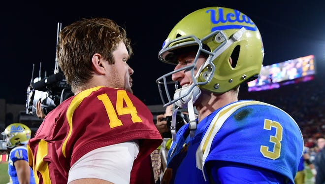 Josh Rosen of the UCLA Bruins and Sam Darnold of the USC Trojans meet on the field after a 28-23 Trojan win at Los Angeles Memorial Coliseum on November 18, 2017 in Los Angeles, California.