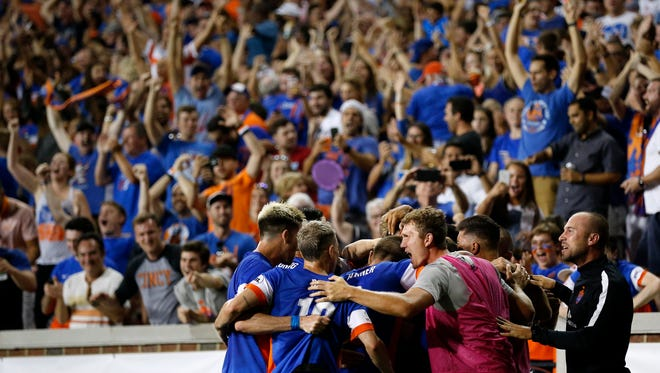 FC Cincinnati celebrates a goal by defender Austin Berry (22) in the second half of the Lamar Hunt U.S. Open Cup Semifinal match between FC Cincinnati and the New York Red Bulls at Nippert Stadium in Cincinnati on Tuesday, Aug. 15, 2017. The Red Bulls came from a 2-0 deficit to win 3-2 in overtime.
