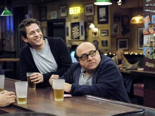 "Glenn Howerton and Danny Devito in a scene from ""Sunny."""