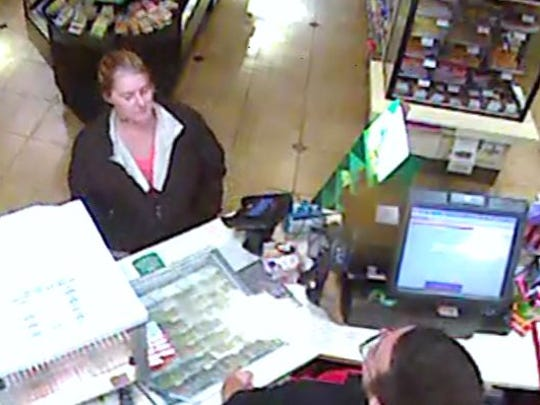 The woman in this picture is the suspect in an armed robbery at 7-Eleven in Powdersville.