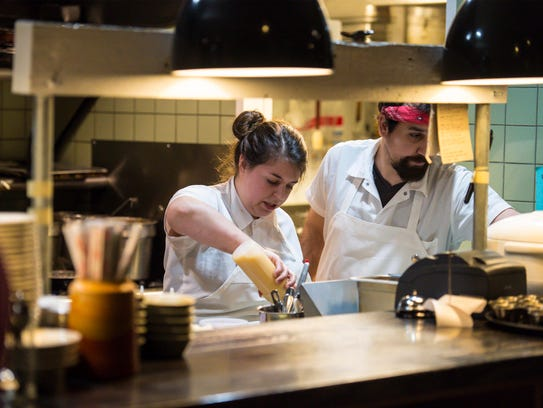 Chef Jaclyn Major, left, works alongside rounds person Nicholas Campine at Butch and Babe's in Burlington on Thursday, February 1, 2018.