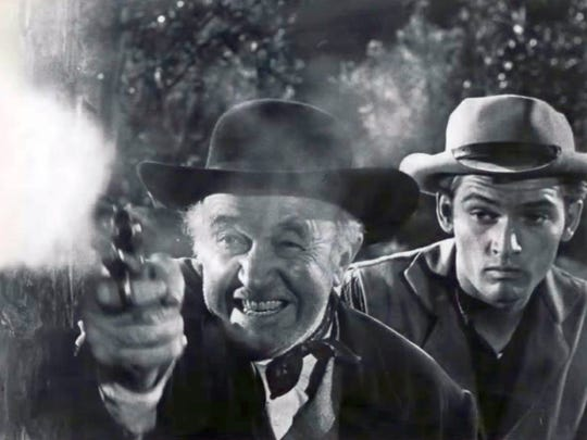Walter Brennan and Chris Robinson in Shootout at Big