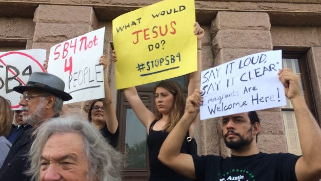 Before the debate on the House floor, opponents of the sanctuary cities bill rally on the steps of the Texas Capitol on Wednesday, April 26, 2017.
