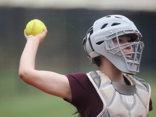 Madison County' catcher Amber Reed and her softball
