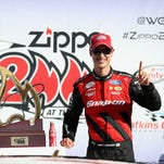 Joey Logano celebrates in victory lane after winning the Zippo 200 at The Glen.