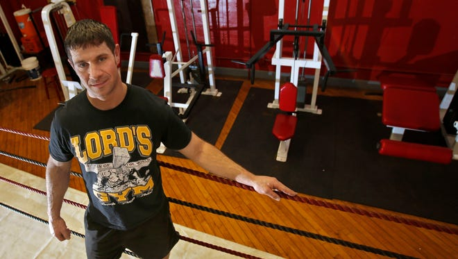 Jimmy Graham, a recovering heroin addict, has learned to fight his addiction by working out at Lord's Gym in Covington.