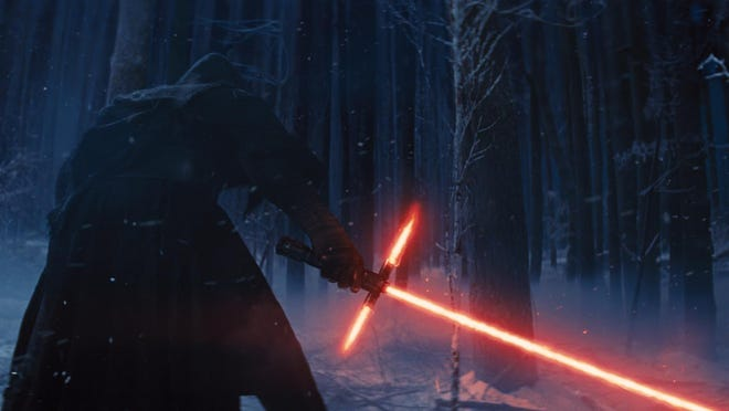 "Adam Driver as Kylo Ren, with his Lightsaber, in a scene from the new film, ""Star Wars: The Force Awakens."""
