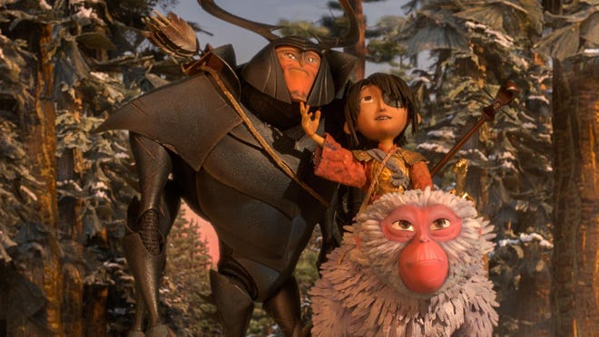 "This image released by Focus Features shows characters, from left, Beetle, voiced by Matthew McConnaghey, Kubo, voiced by Art Parkinson and Monkey, voiced by Charlize Theron in a scene from the animated film, ""Kubo and the Two Strings."""