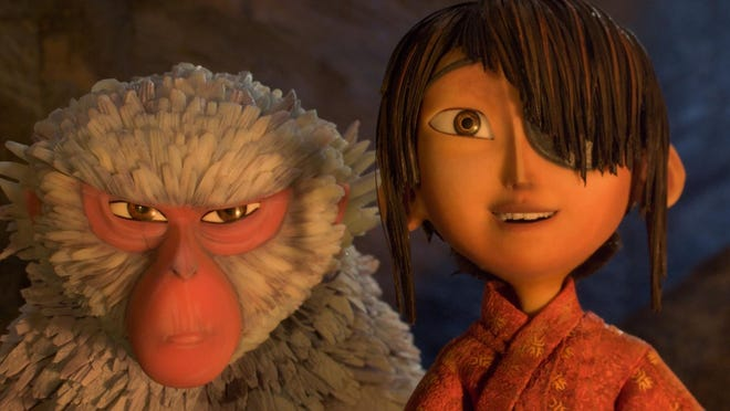 "Kubo, voiced by Art Parkinson (""Game of Thrones""), right, and Monkey, voiced by Charlize Theron are seen in ""Kubo and the Two Strings."""