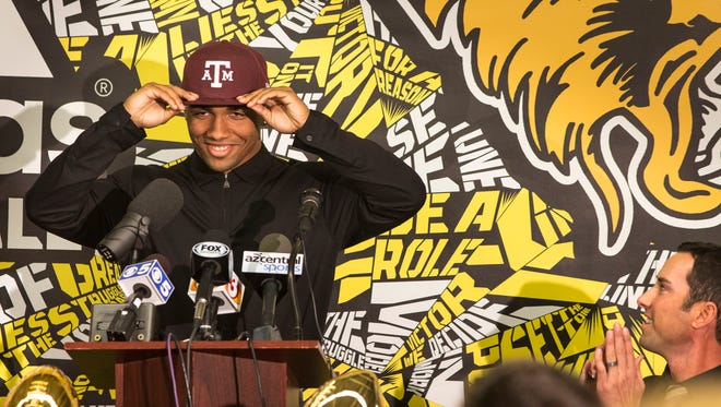 Saguaro High School star football receiver Christian Kirk announces his commitment to Texas A&M, August 17, 2014, during a news conference at the school's community center, 6250 North 82nd Street, Scottsdale.  Looking on is his Saguaro coach, Jason Mohns.