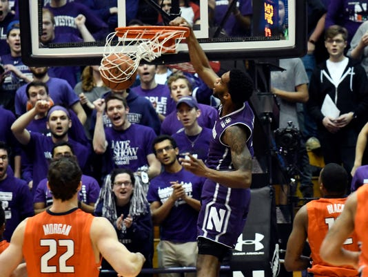 Northwestern forward Vic Law (4) dunks against Illinois during the first half of an NCAA college basketball game Tuesday, Feb. 7, 2017, in Evanston, Ill. (AP Photo/David Banks)