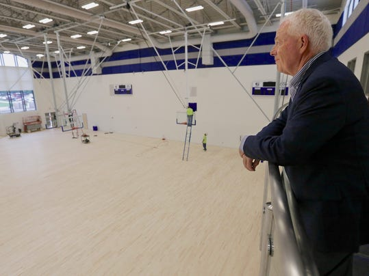 Creighton University Athletic Director Bruce Rasmussen looks over the Kyle Korver Court at Creighton University's newly built Championship Center in Omaha, Neb., Friday, June 6, 2014. The building is a training and academic support facility that is part of the east campus athletic-fitness-recreation corridor. (AP Photo/Nati Harnik)