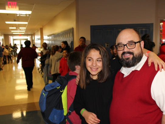 Craig Middle School students, passing by Greg Rake's office in the sixth-grade hallway, pause to pal around with the assistant principal. One of his buddies is Robin Del Rio, who gave him a hug Thursday.