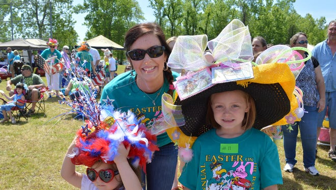 Kayla Sayes is shown with  daughters Chandler (left) and Lauralee at the 2014 Easter on the Red River after winning the Easter Bonnet Contest.