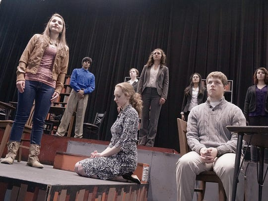 """The Park Players Theatre Company presents """"The Library,"""",a drama about the aftermath of a school shooting. Caitlin Gabriel (Amanda Barberena) is blamed for telling the killer where the students were hiding. Dawn Sheridan (Madison Fifer), kneeling, is the mother of a dead student coming to terms with the reality of the tragic events. Ryan Mayes (Samuel Wilmarth), an eyewitness, blames Caitlin for the loss of life. Nolan Gabriel ( Muhammad Anwar), in background, is Caitlin's father. The publisher (Sam Schikora), Detective Washburn (Sarah Bondy) hopes to uncover the truth. Ms Thornton (Samiha Akbari) is the social worker. Pastor Dunstan (Madeline Damron) wants to help through faith."""