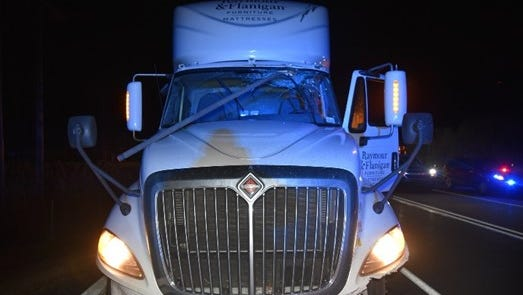 A view of Howard Sexton III's truck, showing a displaced section of electrical conduit that fell on the hood and went through the windshield.