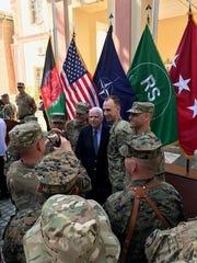 Sen. John McCain, R-Ariz., greets U.S. service members