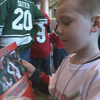 Helping hand for Minn. Warriors hockey team