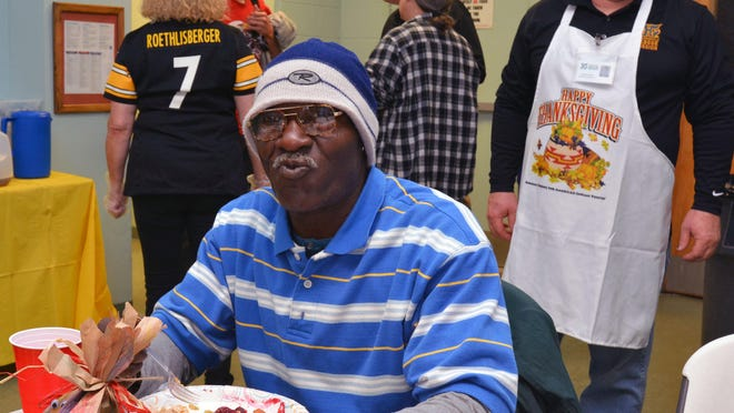Hundreds of people could show up for this year's free Thanksgiving dinner at the Hendersonville Rescue Mission, shown here in 2016, based on past attendance estimates of 300-350 guests.