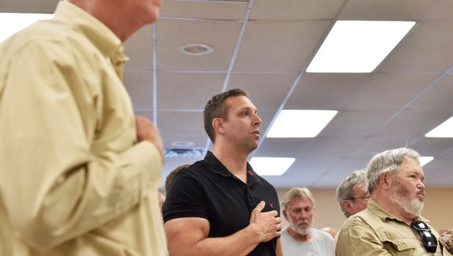 Lt. Cmdr Joshua Corney, whose nightly broadcast of 'Taps' has stirred the borough, attended the meeting.