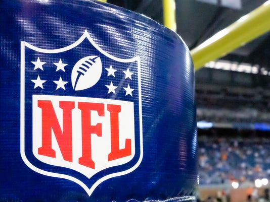 "FILE - This Aug. 9, 2014 file photo shows an NFL logo on a goal post pad before a preseason NFL football game between the Detroit Lions and the Cleveland Browns at Ford Field in Detroit. The NFL Players Association has created a medical guide for players, a 107-page reference book written by scientific professionals with extensive material on concussion detection, treatment and the league's game-day protocol for head injuries. The union's inaugural ""health playbook"" was distributed electronically to NFLPA members this week.  (AP Photo/Rick Osentoski, File)"