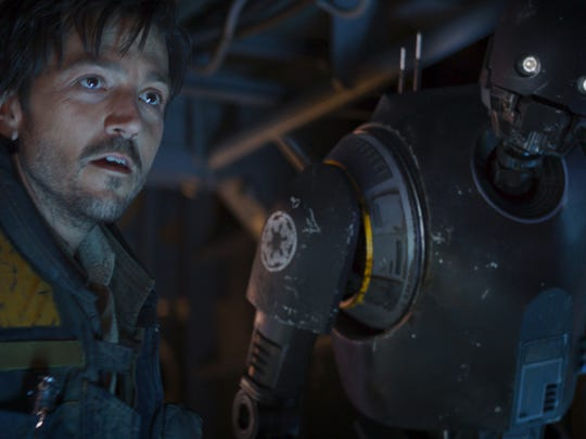 Cassian Andor (Diego Luna, left) reprogrammed K-2SO (Alan Tudyk) so that he's on the side of the Rebellion.