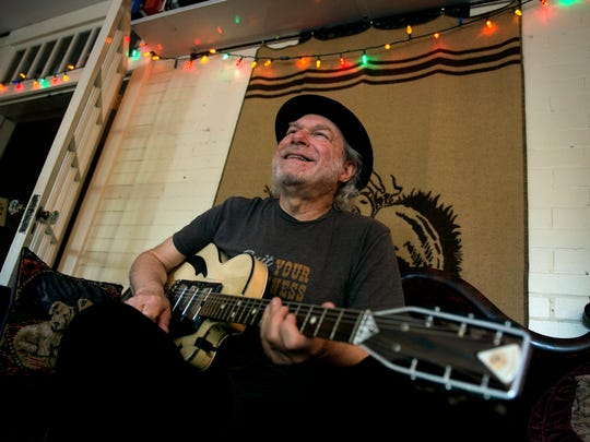 """Buddy Miller smiles while posing for a portrait and speaking to The Tennessean at his studio Friday, June 29, 2018, in Nashville, Tenn. Miller will be featured in the new series """"Americana at the Ryman"""" with Lee Ann Womack, Tony Joe White, The McCrary Sisters, Parker Millsap and Elizabeth Cook this summer at the Ryman Auditorium."""