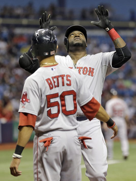 Boston Red Sox's David Ortiz, right, celebrates with Mookie Betts after hitting a three-run home run off Tampa Bay Rays starting pitcher Matt Moore during the first inning of a baseball game Saturday, Sept. 12, 2015, in St. Petersburg, Fla.  The home run was Ortiz's 499th of his career. (AP Photo/Chris O'Meara)