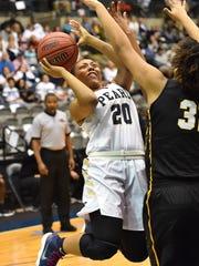Pearl's Jayla Alexander (20) shoots against Starkville