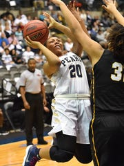 Pearl's Jayla Alexander (20) shoots against Starkville on Wednesday during the MHSAA Class 6A state semifinals at the Coliseum in Jackson.