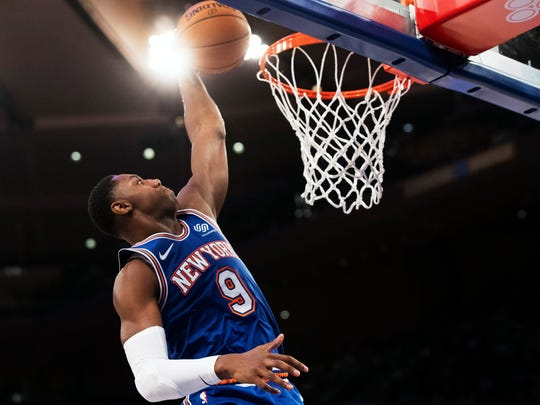 New York Knicks forward RJ Barrett dunks in the first half of an NBA basketball game against the San Antonio Spurs, Saturday, Nov. 23, 2019, at Madison Square Garden in New York. (AP Photo/Mary Altaffer)