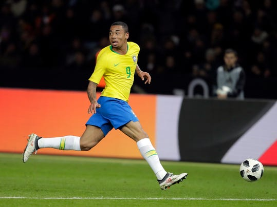 Brazil's Gabriel Jesus runs with the ball during the international friendly soccer match between Germany and Brazil in Berlin, Germany, Tuesday, March 27, 2018. (AP Photo/Markus Schreiber)