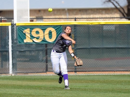 Hardin-Simmons left fielder Laura Guerrero (6) throws the ball back into the infield during the Cowgirls' 10-1, six-inning loss to Mary Hardin-Baylor at Ellis Field on Wednesday, March 21, 2018.