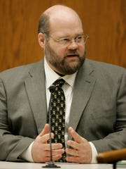 John Ertl, a forensic scientist with the Wisconsin State Crime Lab in Madison, opened testimony in the Steven Avery murder trial at the Calumet County Courthouse.