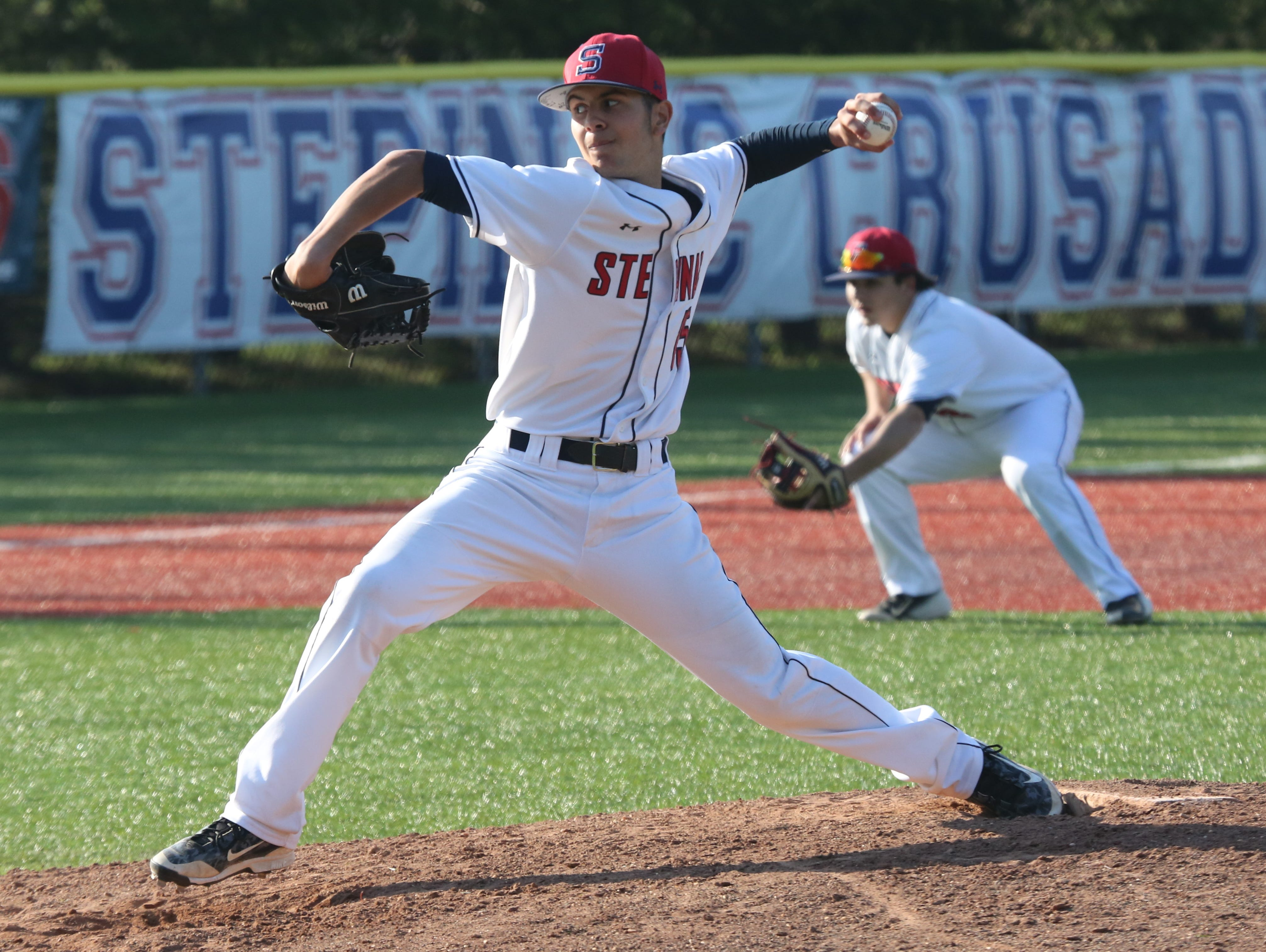 Archbishop Stepinac pitcher Austin Mercado delivers a pitch against Iona Prep during their baseball game at Stepinac in White Plains, April 27, 2016.