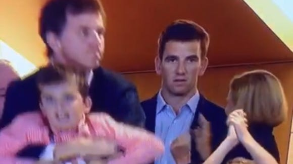 Eli Manning doesn't seem as excited as the rest of his family about his brother Peyton Manning's Denver Broncos scoring a touchdown