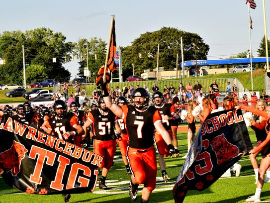 MasonParris leads the Lawrenceburg Tigers on the field
