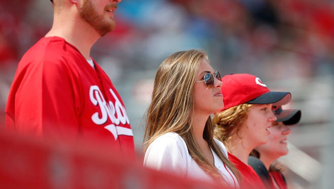 Cincinnati Reds fans watch the game in the ninth inning during the MLB game between the Colorado Rockies and the Cincinnati Reds, Wednesday, April 20, 2016, at Great American Ball Park in Cincinnati.
