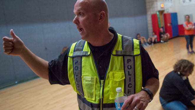 School resource officer Jeff Holpuch trains educators during an active shooter simulation at Kinard Middle School in this file photo.