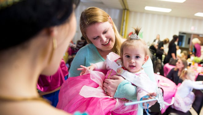 Liliana Boccia, 1, meets Princess Jasmine during a princess teatime hosted by the Black Rose Rollers at the Hanover YWCA on Saturday, Feb. 11, 2017.