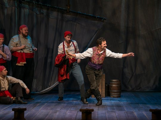 """Charles Pasternak, center, is hilarious as Black Stache in the Clarence Brown Theatre's season opening """"Peter and the Starcatcher."""""""