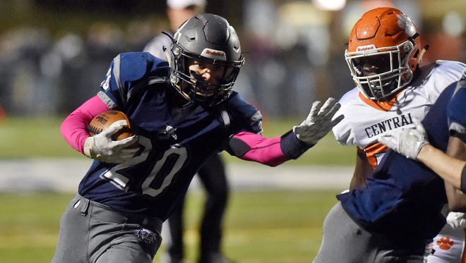 Dallastown's Max Teyral carries the ball for a touchdown against Central York in the first half of a YAIAA football game Friday, Oct. 28, 2016, at Dallastown.