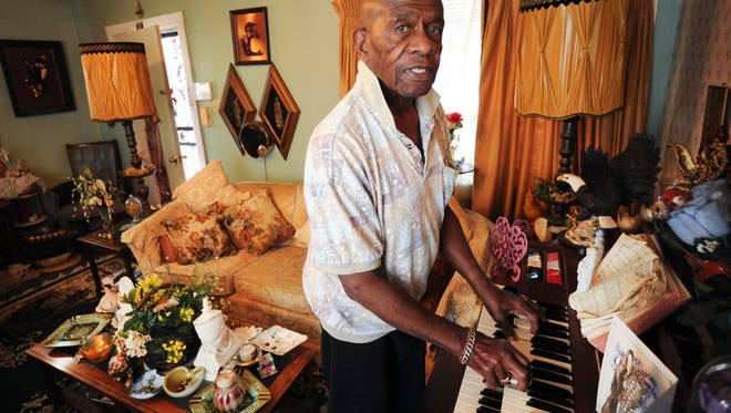 "James ""Jimmy"" Battle plays his favorite hymn 'Sweet Hour of Prayer' on Tuesday, Nov. 22, 2016, at his East Knoxville home. The 83-year-old, who will received his first Empty Stocking Fund basket this Christmas, works at a local Alzheimer's unit with many of the patients much younger than him."