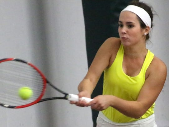 Catholic Memorial doubles player Catherine Raster backhands